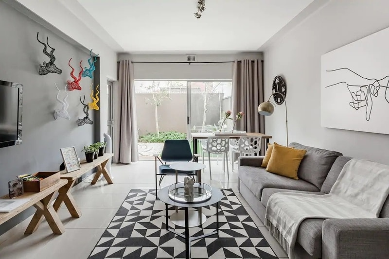 monochromatic-lounge-dining-area-airbnb-cape-town