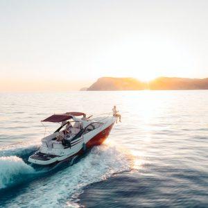 Yacht riding on a beach with a sunset
